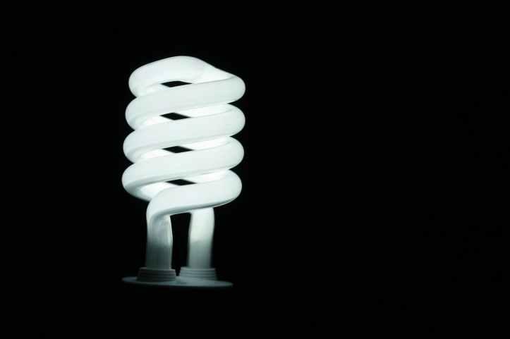 illuminated lamp against black background
