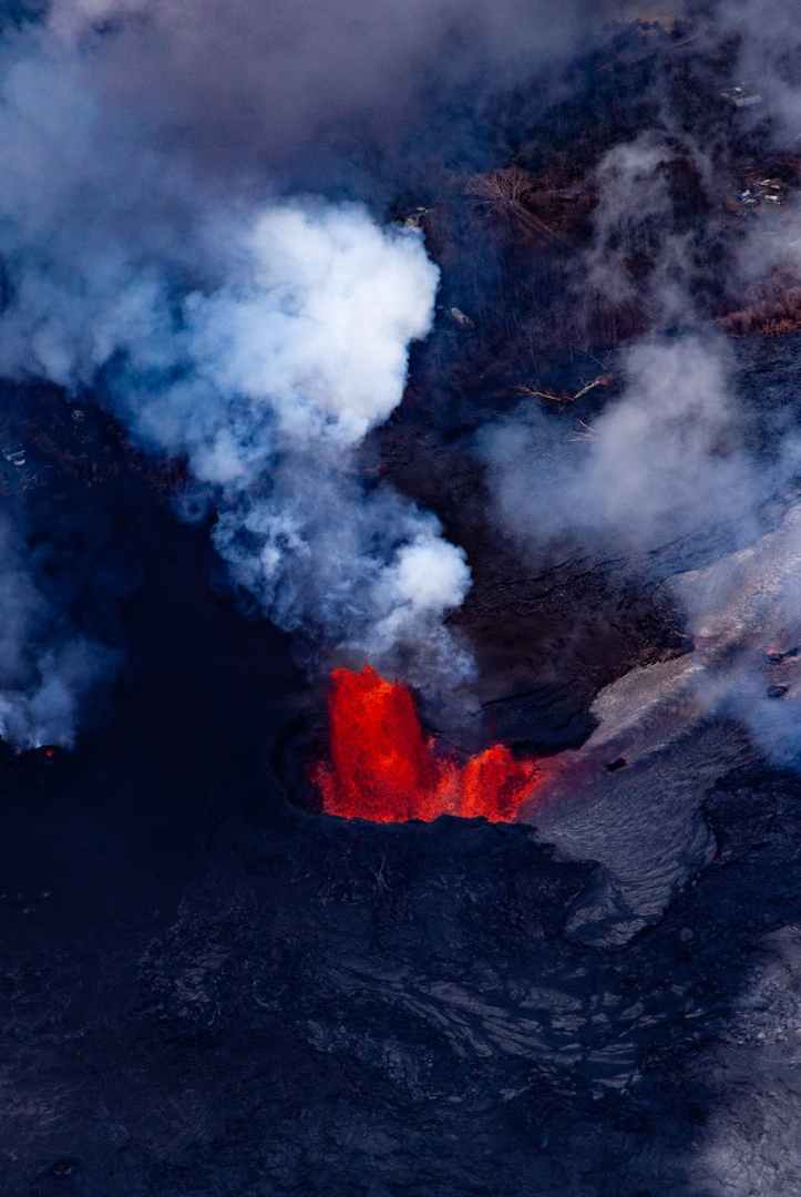 red lava and smoke of volcano