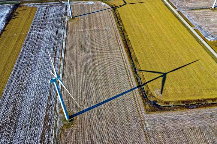 high angle photo of wind turbine on field