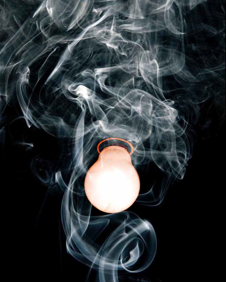 close up photo of light bulb with smoke