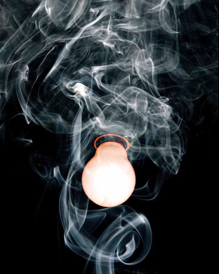 close up photo of light bulb with smoke