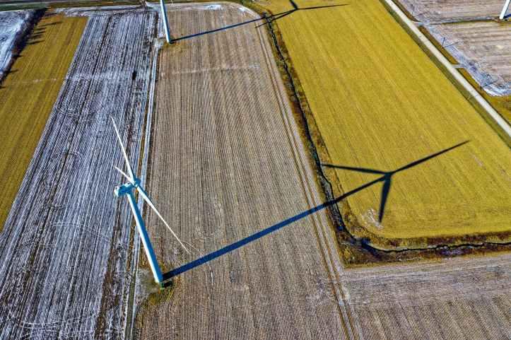 high angle photo of wind turbine on field