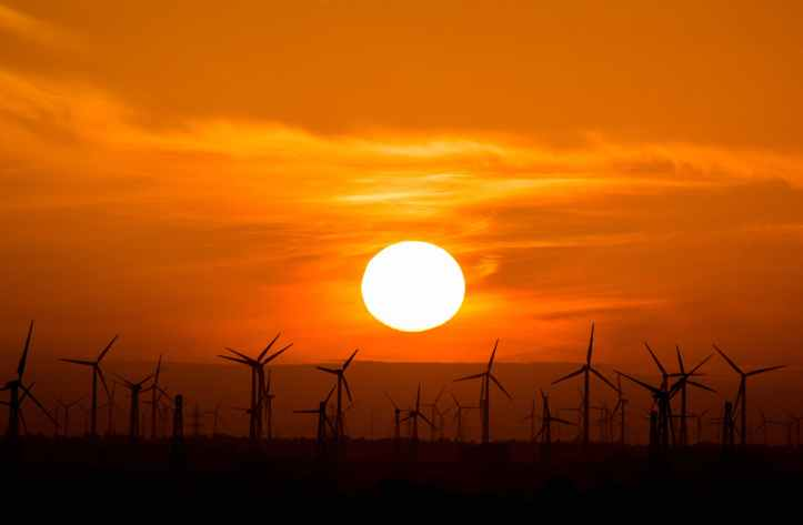 photo of wind turbines during golden hour